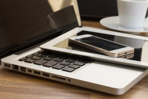 modern computer gadgets - laptop, tablet and phone close up